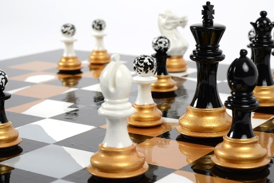 Darren-John-hand-painted-chess-set-pieces-in-play-with-Black-King